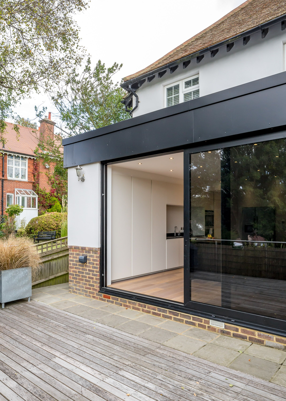 Huge Floor To Ceiling Sliding Glass Door To Rear Extension
