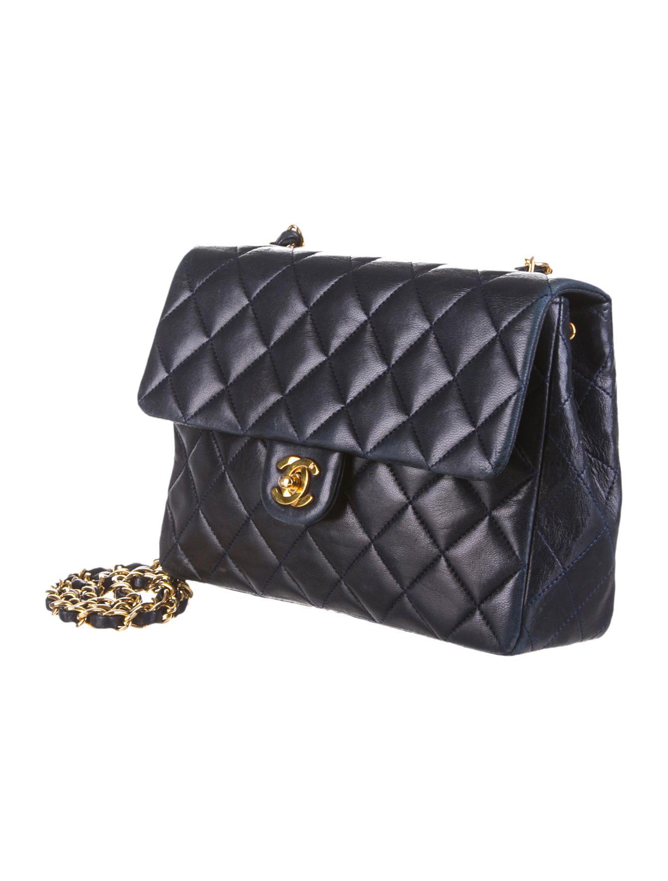 a6dae7dda92c Navy blue quilted leather Chanel vintage Mini Flap bag with brass hardware.  Measurements: Shoulder Strap Drop 20