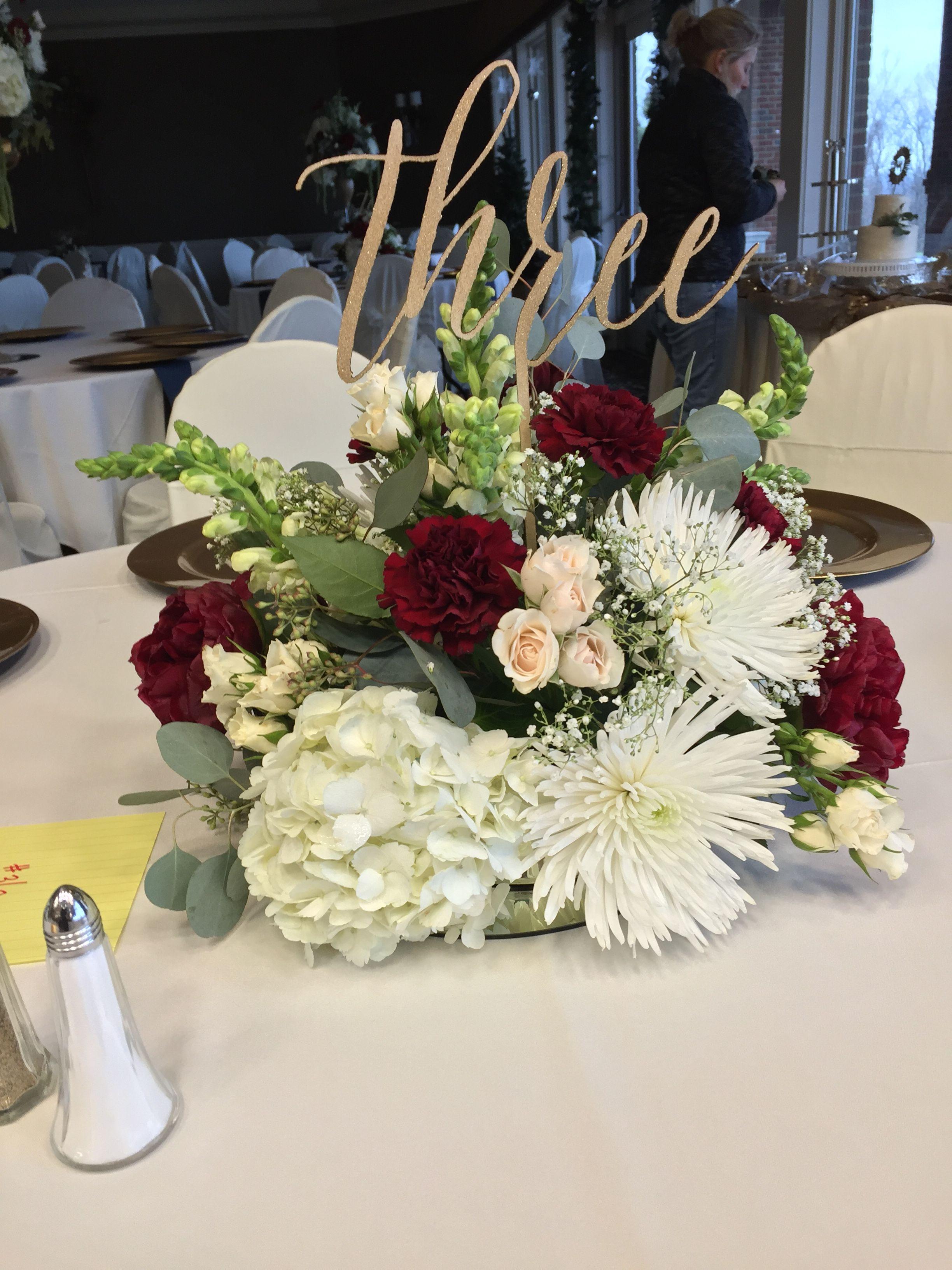 Centerpiece With Burgundy Carnations White Spider Mums Cream Spr Flower Centerpieces Wedding Burgundy Wedding Centerpieces White Wedding Flowers Centerpieces