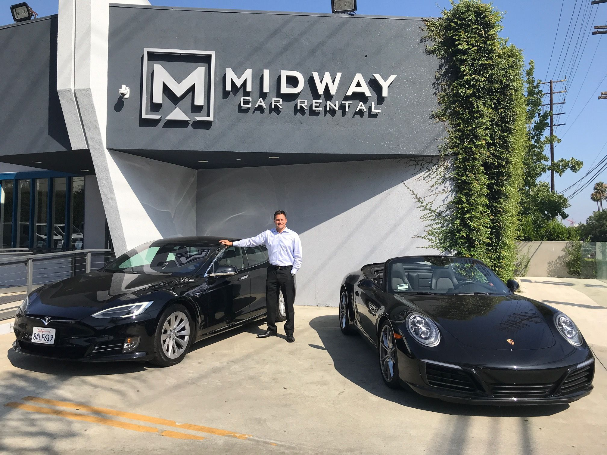 Midway Managing Director Of Sales And Marketing Ryan Kerzner Stands With Two Of The Companies Luxury Rent Car Rental Company Sales And Marketing Luxury Rentals