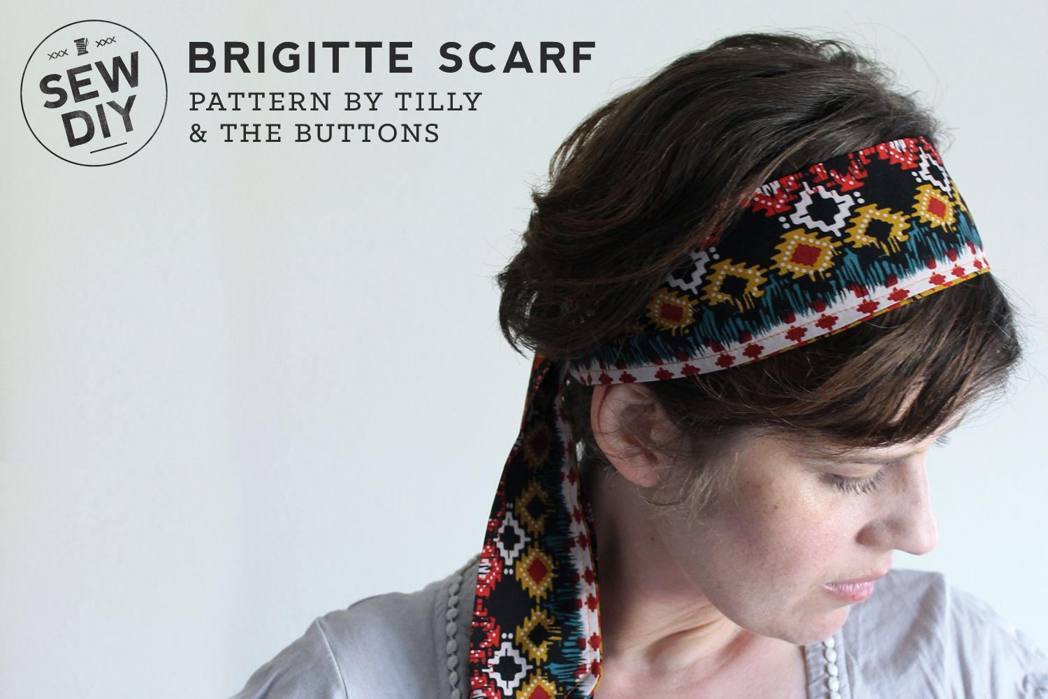 Today I'm really excited to share a DIY designed by Tilly from Tilly and  the Buttons –the Brigitte Scarf. This is a very easy DIY, the perfect  project for a beginning sewist. Tilly's instructions are detailed and very  easy to follow.For my scarf I used a tribal print fabric leftover from a  skirt that I helped my niece make. I love this scarf and haven't taken it  off since I first put it on! This basic shape that can be worn around the  neck, as a belt or tied onto a bag.