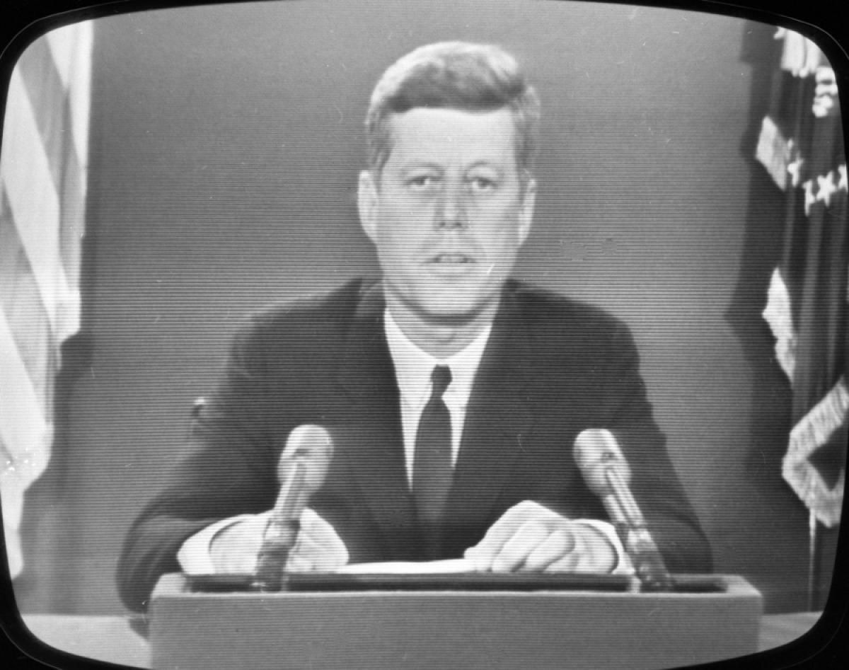 Americans tune in as President Kennedy appears on television in 1962 to speak to the country about the confrontation between the United States and the Soviet Union in Cuba.