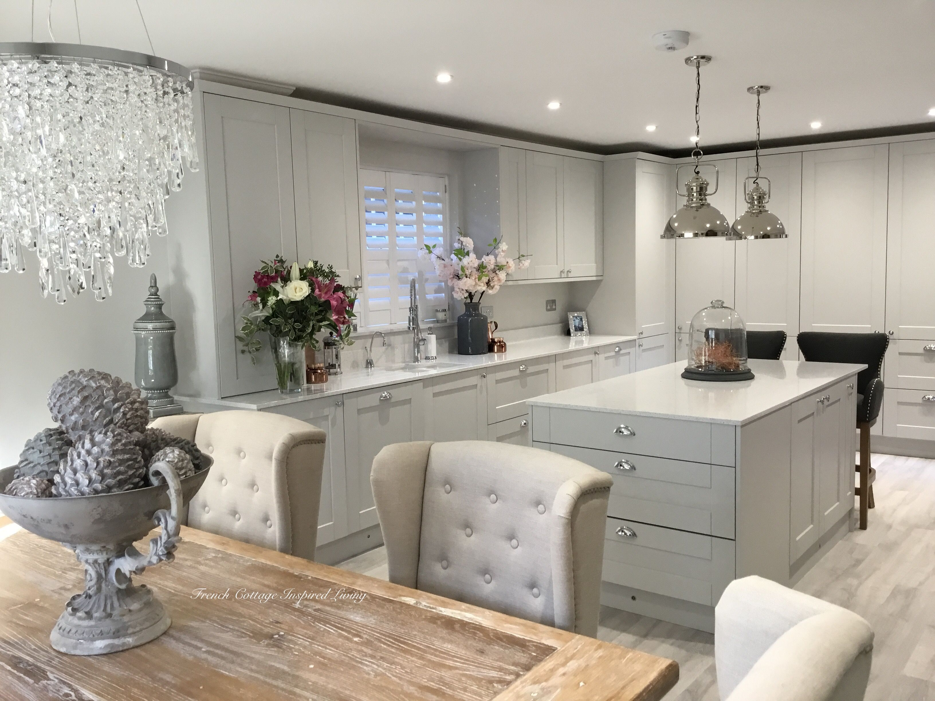 Howdens kitchen selecting extra high cupboards and white