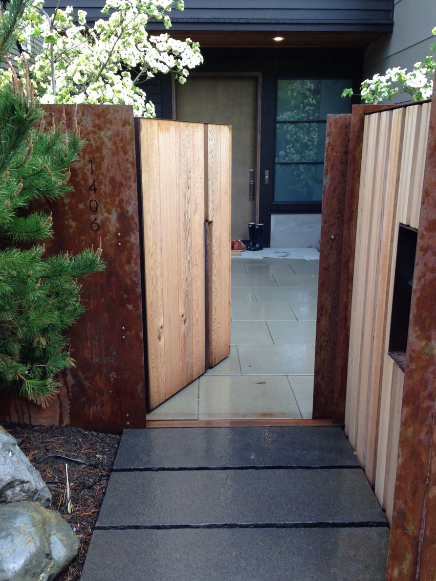 Corten steel and cedar gate. Nice contrast wood against steel ...