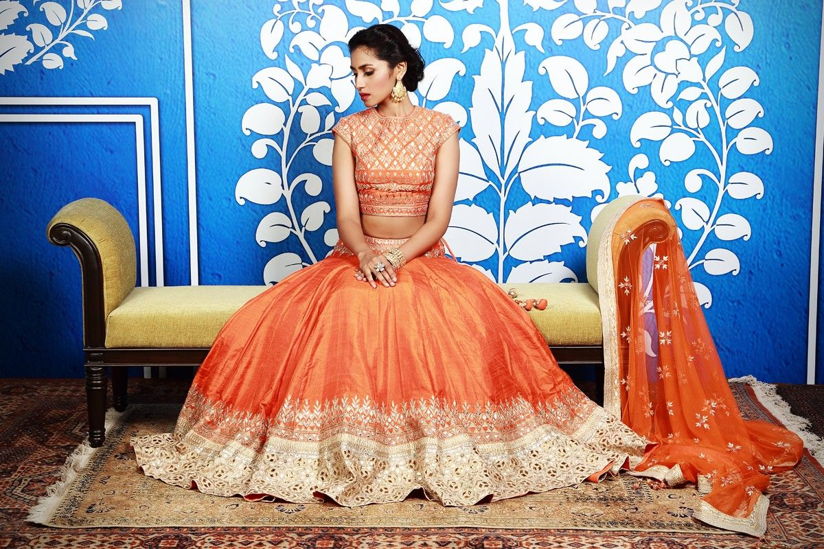 This chic orange lehenga set is one of the most desired outfit from
