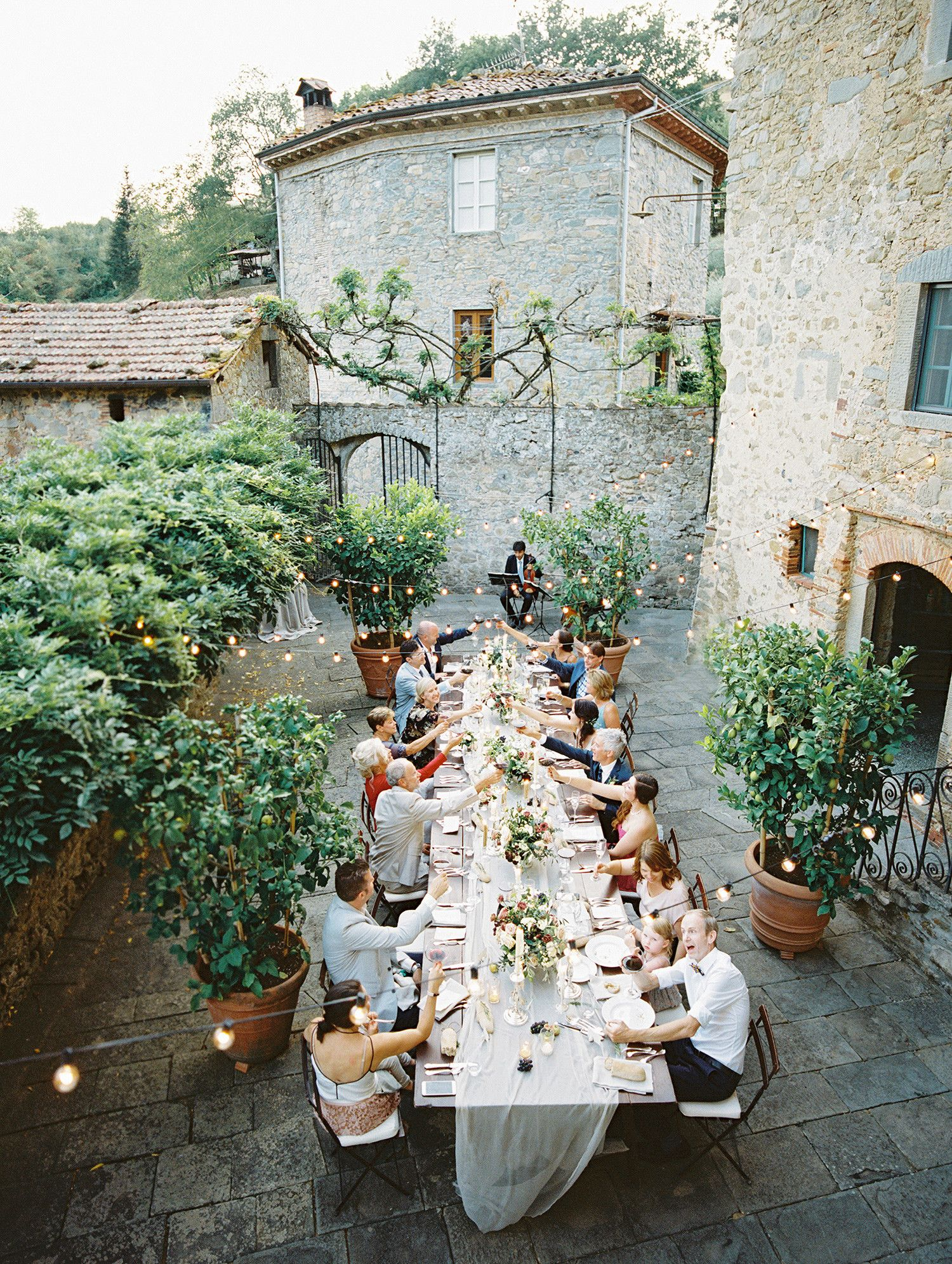 This Intimate Destination Wedding in Tuscany Had Just 16 Guests is part of Tuscany wedding - With just 16 guests in attendance, one couple traveled to Tuscany, Italy, for an intimate destination wedding  The couple celebrated with an elegant multicourse dinner served ata gorgeous receptioninspired by the Italian countryside