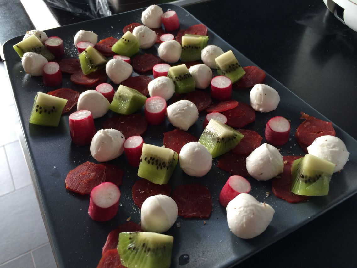 Mozzarella, chorizo, kiwi, radish plate for the summer