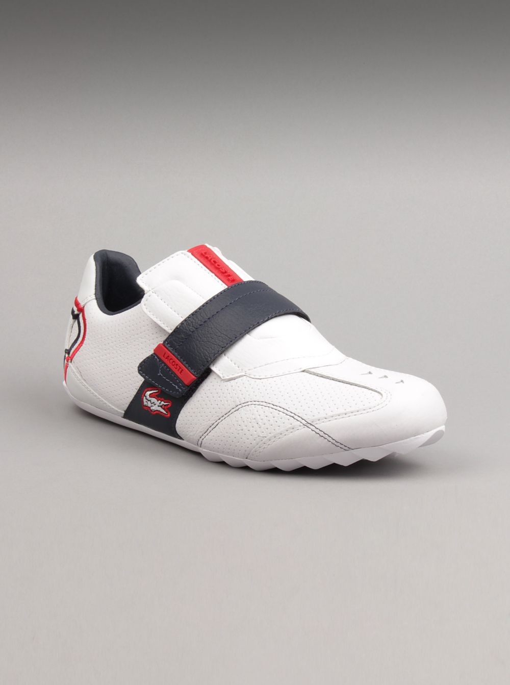 86c10d62f Lacoste Men Swerve Shoes in White and Red Sporty and sophisticated.This  style features a suede and synthetic leather upper with intricate stitching  detail