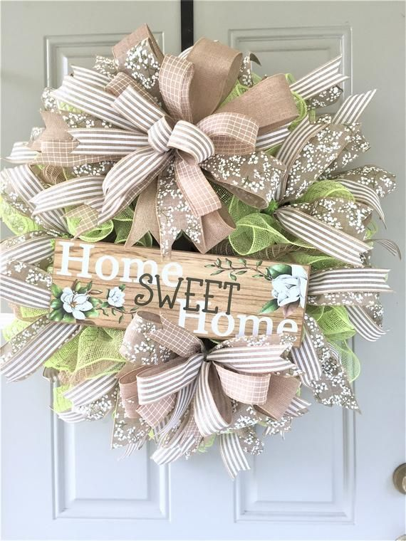 Photo of Welcome wreath of the front door, sweet main sign of the house, rustic country decor