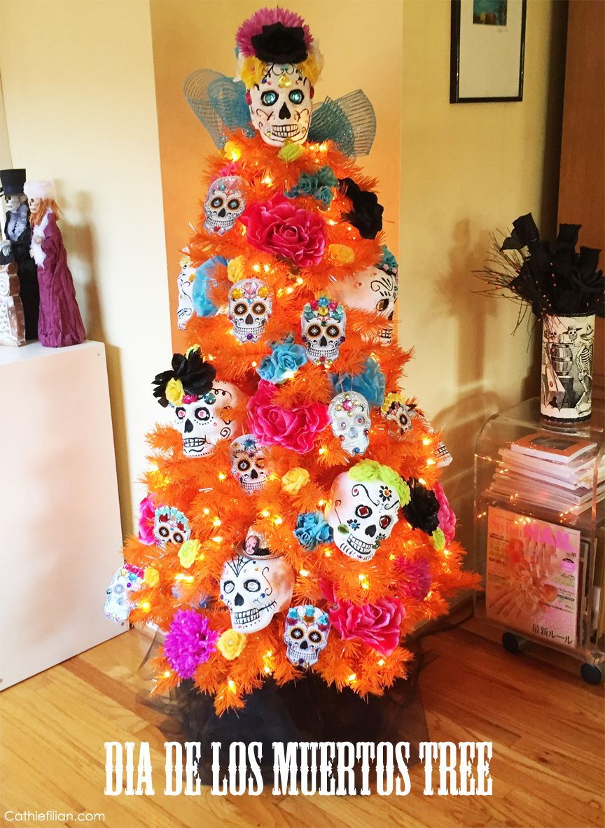 DIY Dia de los Muertos Tree! The Day of the Dead Sugar Skull ornaments were made with foam skulls and paper plates.