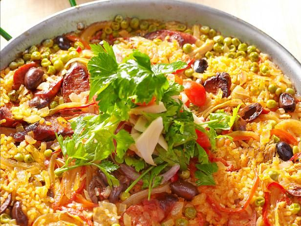Try this at home how to make paella paella and chorizo iron chef jose garces invites food network magazine to his philadelphia home to make paella forumfinder Images