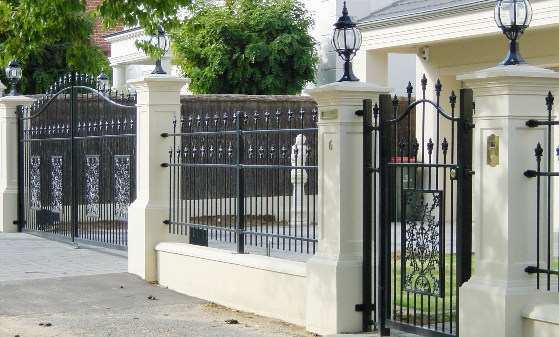 Brick Column And White Fence With Gate