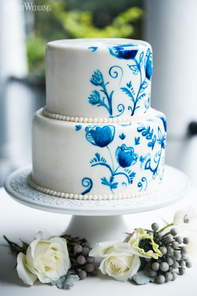 a simple blue watercolour & gold wedding cake which was finished