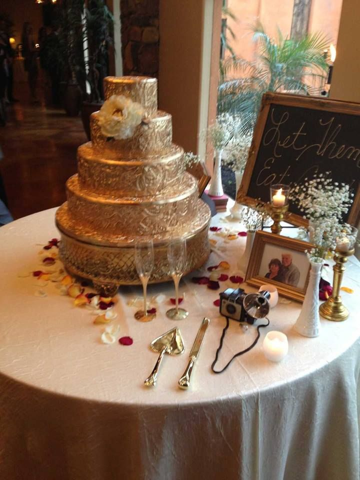 The Cake Table Included Pictures Of Out Parents With Brass