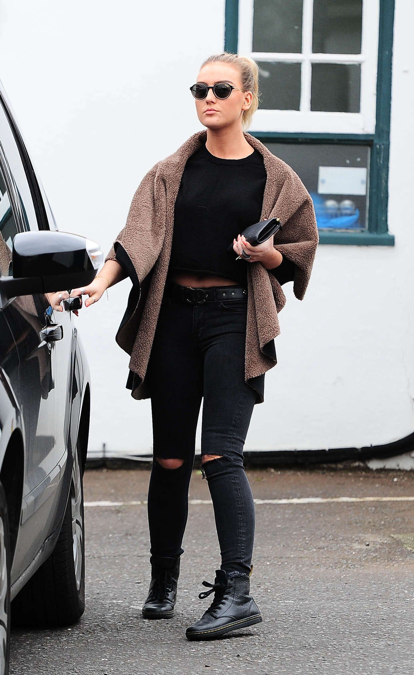 Perrie visiting a vet clinic in London Perrie edwards