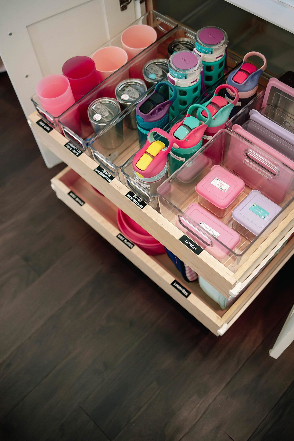 How to organize kids tupperware, water bottles, and plates in the kitchen. How to organize the kids drawer. Tips for organizing the kids kitchen cabinet. Our Home : The Kids Cabinet – Mika Perry #organizekitchen