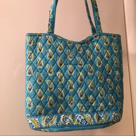 Vera Bradley Bermuda Blue tote This is a retired pattern from 2005 by Vera Bradley. The bag is a standard size tote, with a magnet snap enclosure and inside pockets on both sides, including a zipper pocket. Great condition, and machine washable. Vera Bradley Bags Totes