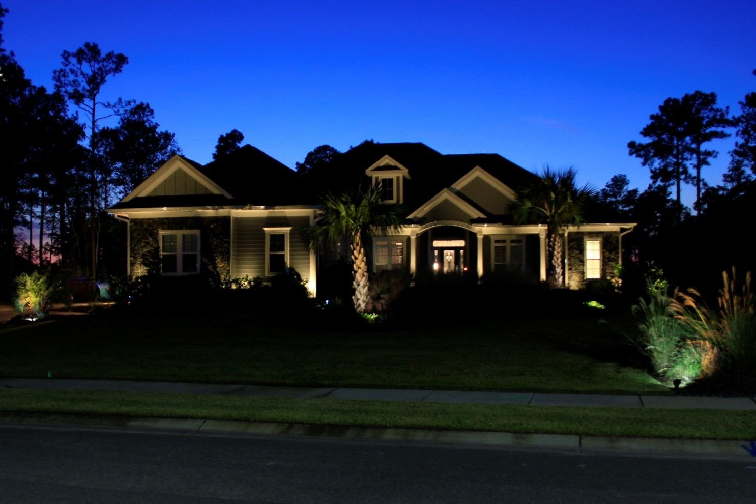 Resort Style Home Lighting Why Do I Need Landscape Lighting You May Wonder Aesthetics Security Outdoorentertainment Curbappeal Need Home Lighting Landscape Lighting Resort Style