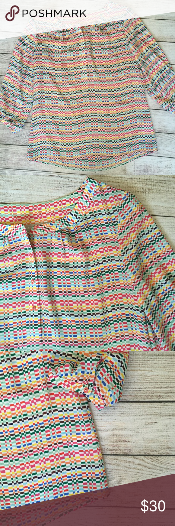 """Banana Republic Multi-Color Blouse Multi-color print throughout. 3/4 sleeves with button detail. Loose fit. 25""""L shoulder to hem. 100% polyester. EUC- no signs of wear. 🚫NO TRADES/NO MODELING🚫 Banana Republic Tops Blouses"""