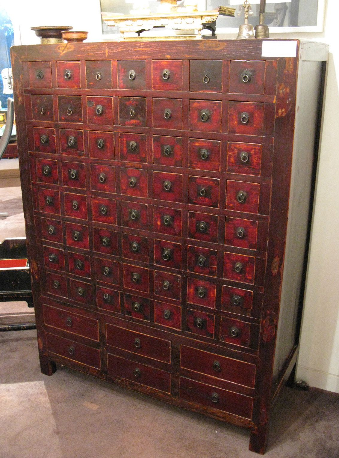 From The Name Of The Photo This Is A Century Antique Chinese Apothecary  Tall Cabinet With 56 Small Drawers And 6 Large Drawers.