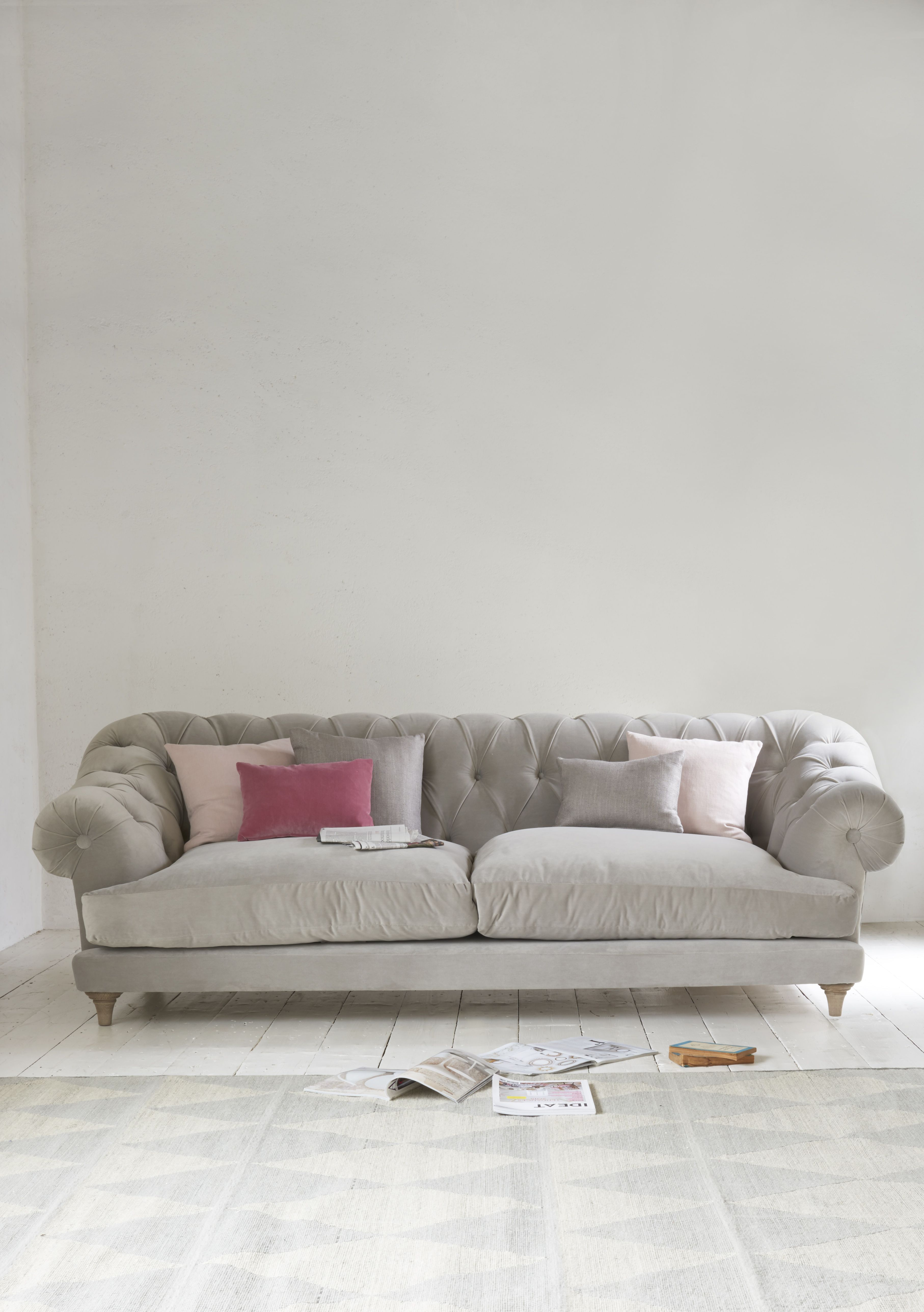 Gentil Loafu0027s Deep Buttoned Chesterfield Bagsie Sofa In A Soft And Light Smoky  Grey Velvet In This Airy Living Room