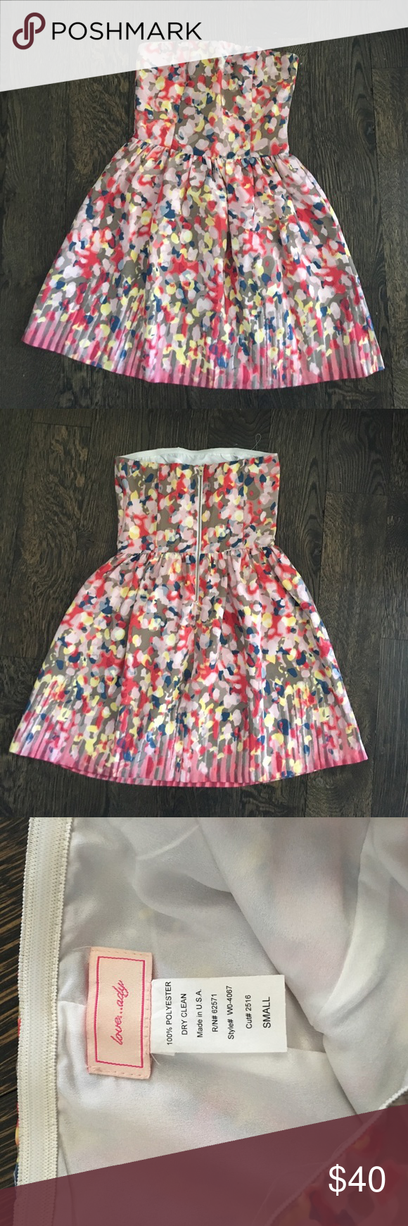 Strapless dress Really cute strapless dress with zipper detail in the back. I wore it once to a bridal shower and got so many compliments! love...ady Dresses Strapless