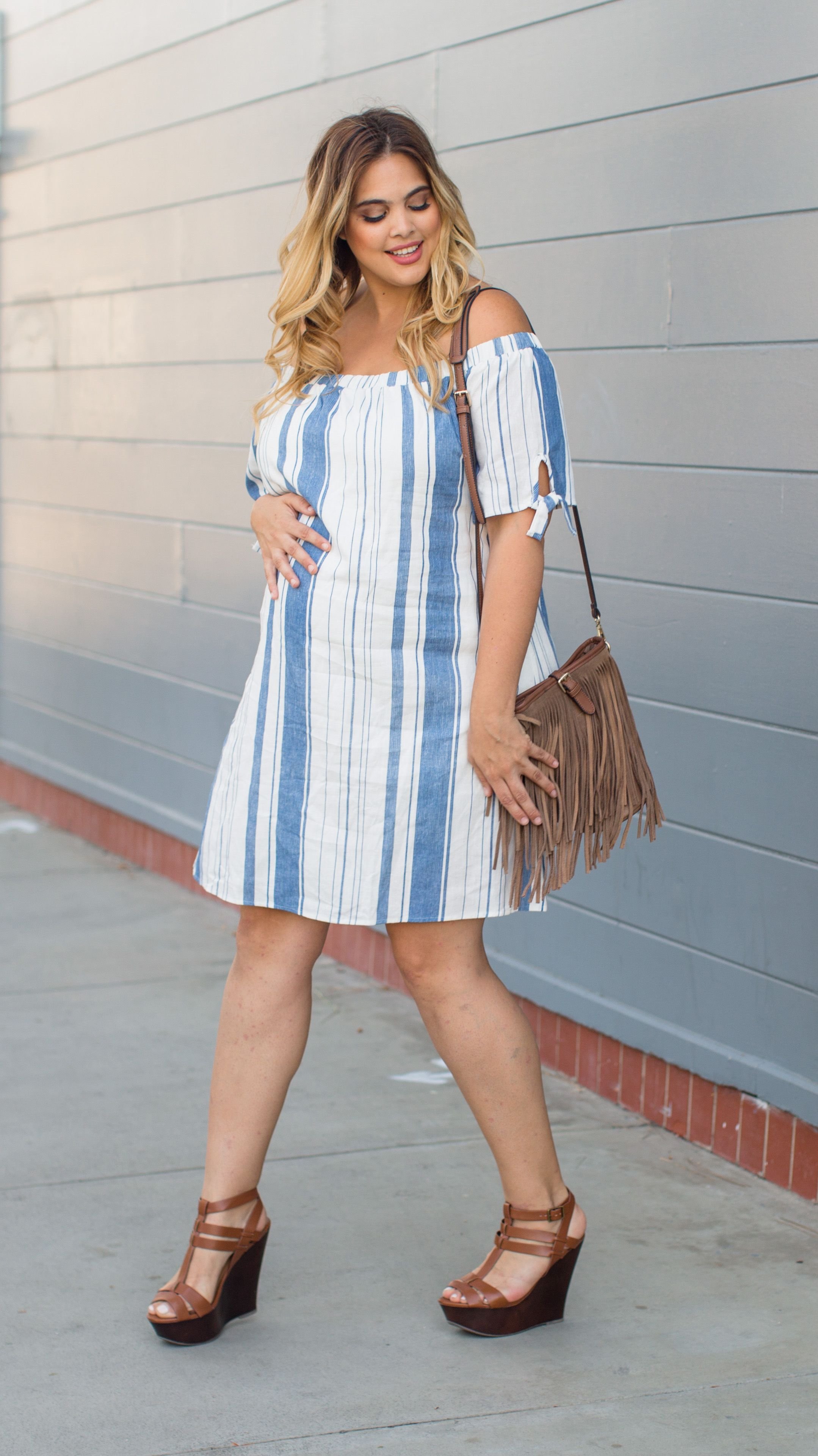 c52e406bf038c We're in love with this off shoulder maternity dress. The striped print and  tie details on the sleeves make this dress your new on trend staple this  season.