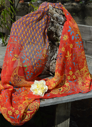 #Chiffon #Scarves - Beautiful rich Lipstick Red background with exotic Peacocks. Give your wardrobe a makeover this Spring with some new accessories. Lovely Silks has an April Offer buy one chiffon scarf & get a second one for free. Why not treat yourself & a friend today?