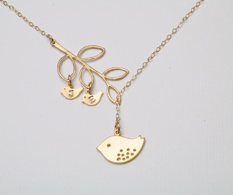 Gold Bird initial,Bird Necklace,Mom and baby,Mother Jewelry,Initial necklace,Mother's day,Family Bird,Lariat Sterling Silver Necklace. $38.50, via Etsy.