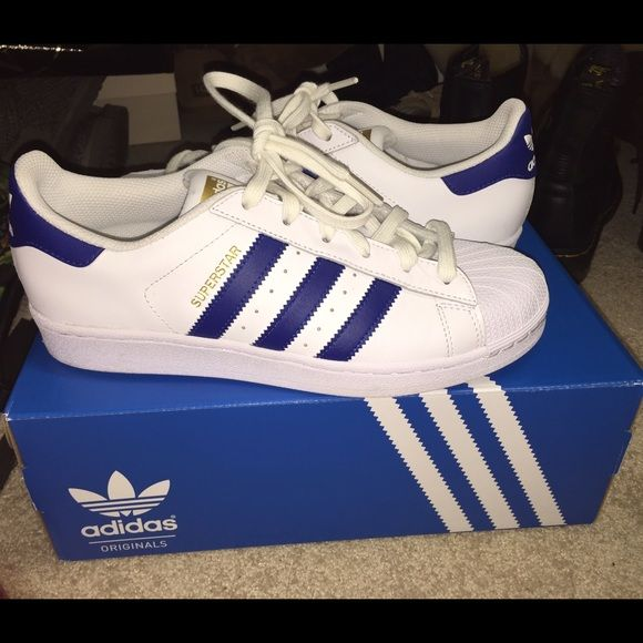 Brand new Adidas Superstars never worn blue strip Adidas superstars!!! Classic style, fresh out of the box  selling because they're too big on me. Adidas Shoes Sneakers