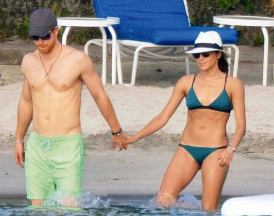 Meghan Markle's 9 Best Swimsuit Moments - Dress Like A Duchess. Meghan Markle wearing the Morgan teal bikini with Prince Harry in Jamaica.