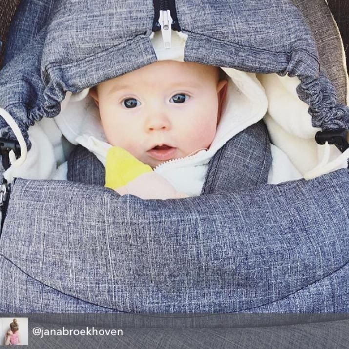 Peekaboo! #Baby is comfy, cozy & warm with #Stokke stroller accessories