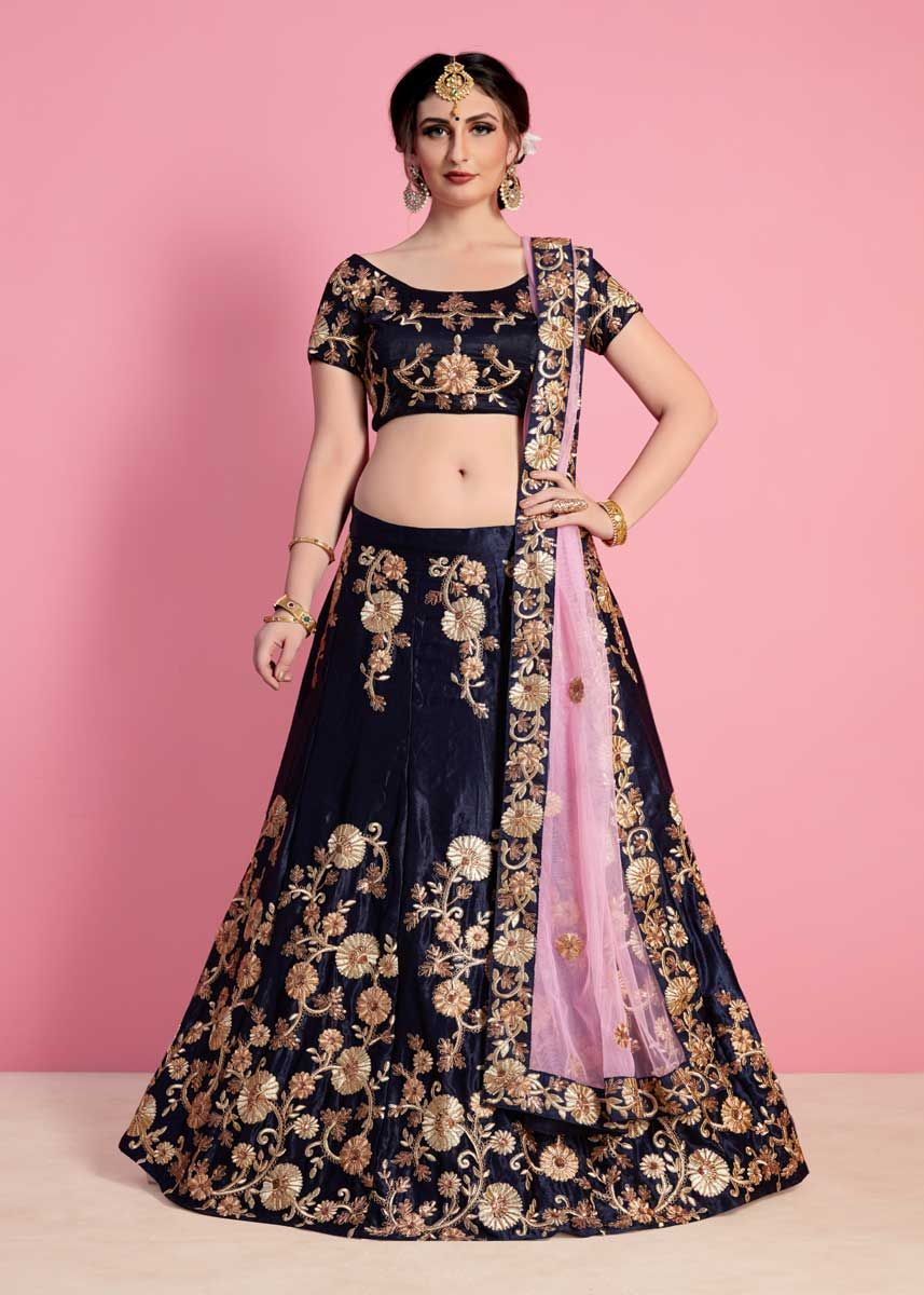 a12e8489e3 Crafted with stunning design in mind, this fancy navy blue color velvet  silk embroidered wedding wear lehenga choli will become your new closet  favorite.