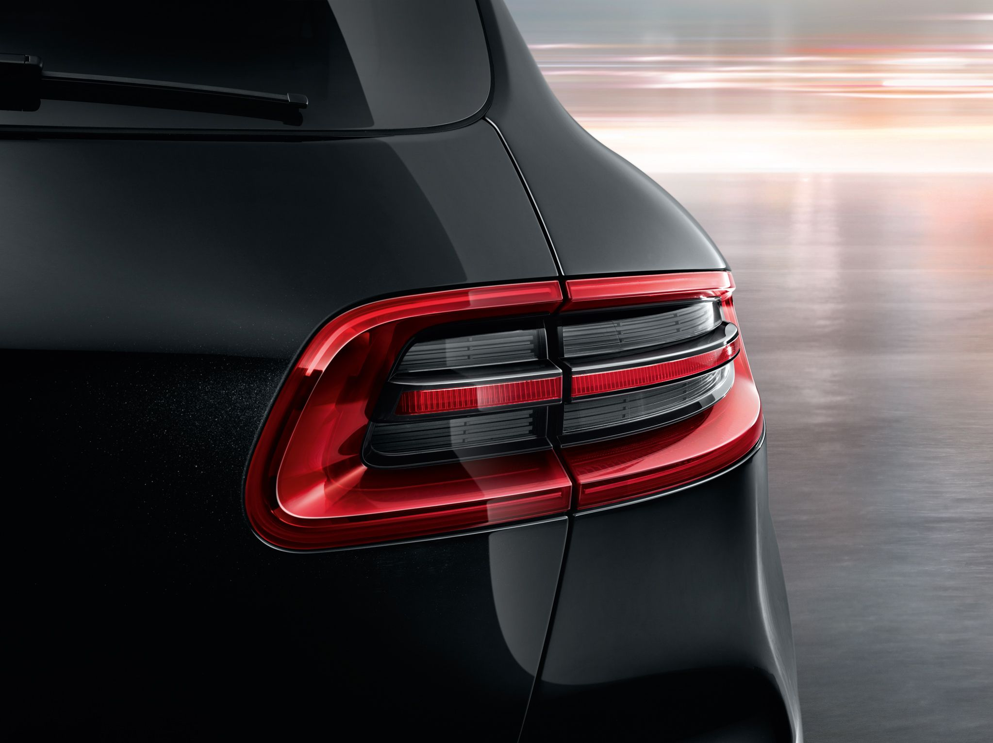 PorscheMacan The narrow LED tail lights have a three