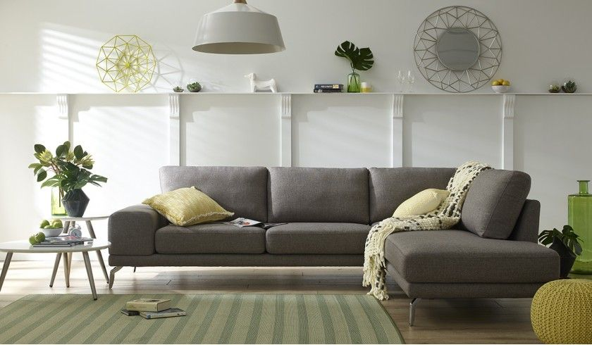 Madison corner chaise lounge with some amazing touches of yellow - we love the knitted pouff!