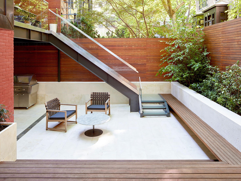 The Endlessly Adaptable Row House Urban Omnibus Outdoor Stairs Row House Townhouse Row house backyard design