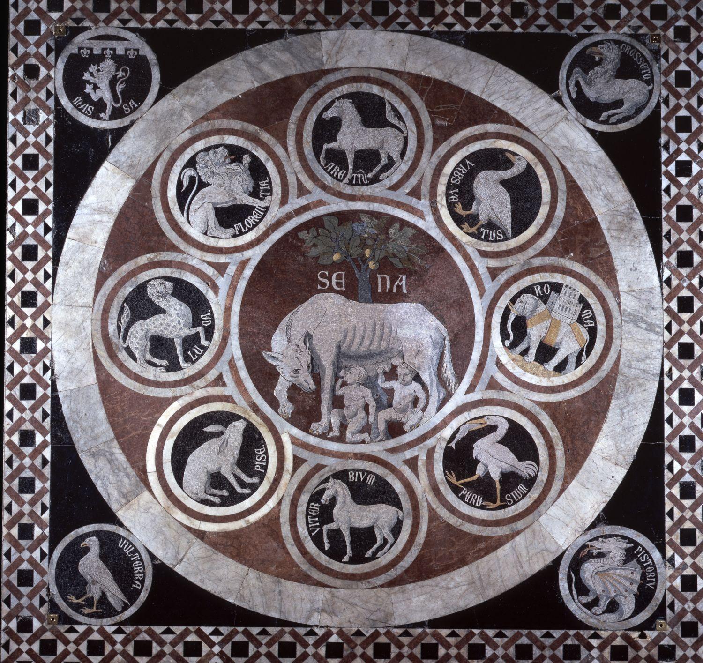 """Una veduta complessiva della zona sotto la cupola del Duomo """"Il più bello…, grande e magnifico… che mai fusse stato fatto"""". Certo, chi conosca anche un po' Giorgio Vasari e le sue famose """"Vite"""", sa bene che il personaggio non era propriamente immune dalle iperboli, da magniloquenza, enfasi, ridondanza. Eppure, se riserva – come riserva - questa parole al Pavimento a commesso marmoreo della Cattedrale di Siena, qualche fondamento deve esserci: e anzi, probabilmente in questo caso non si…"""