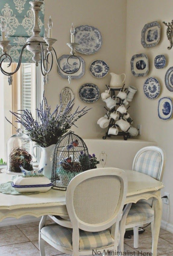 Blue And White Transferware Plates Hanging In A Dining Room