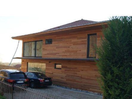 Pose du bardage bois sur les facades du0027une maison ossature