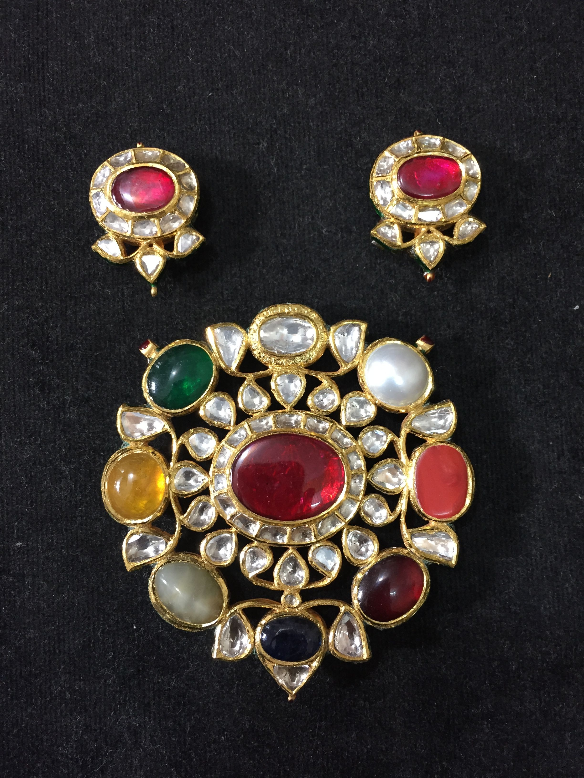 Navratan pendant and earings setted in gold with nine precious