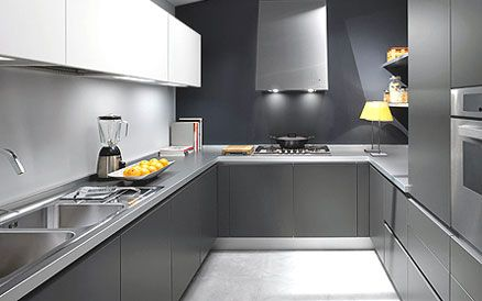 grey kitchen cabinets with grey wood flooring