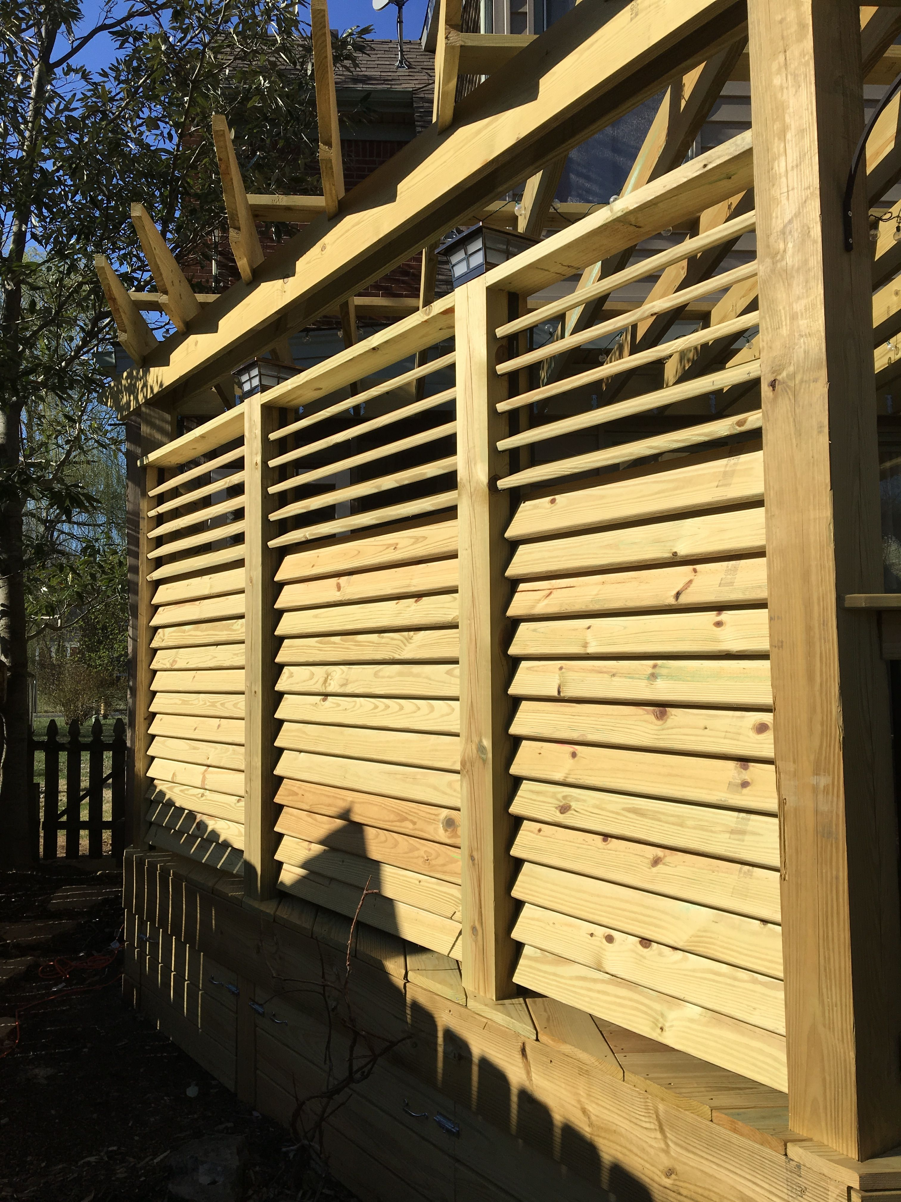 exterior view of a louvered fence project. the hardware system