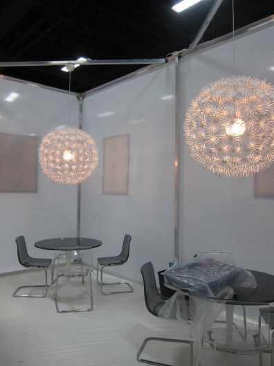 Ambient Starburst light pendants over cafe tables ...