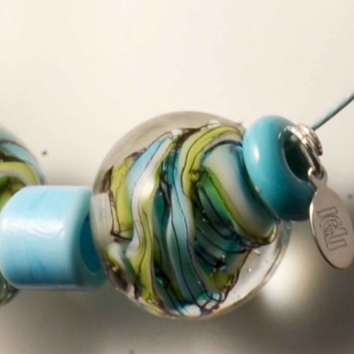 White, turquoise, apple green glass and hair black stringer swirl inside clear transparent glass to make this solid, marble like beads. Simple elegant everyday stunning glass necklace. Lampwork. Comes in a handcrafted wooden gift box