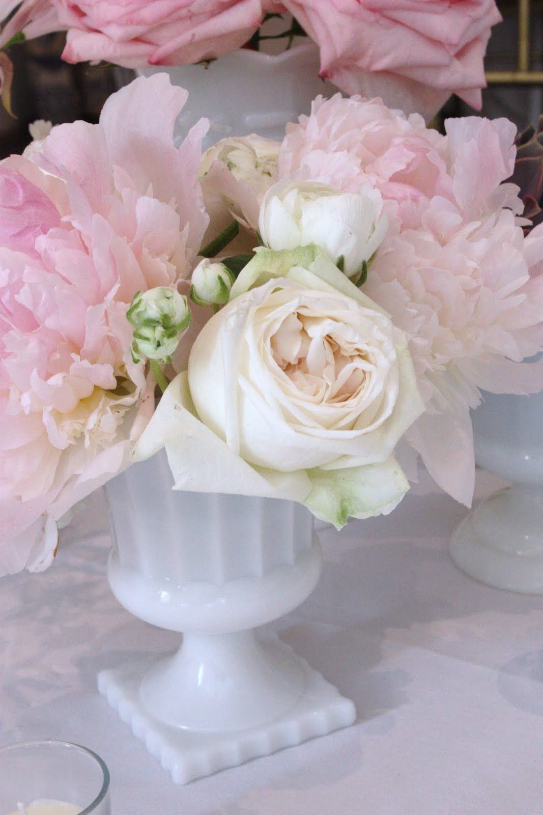Milk glass centerpiece with cream roses and pink
