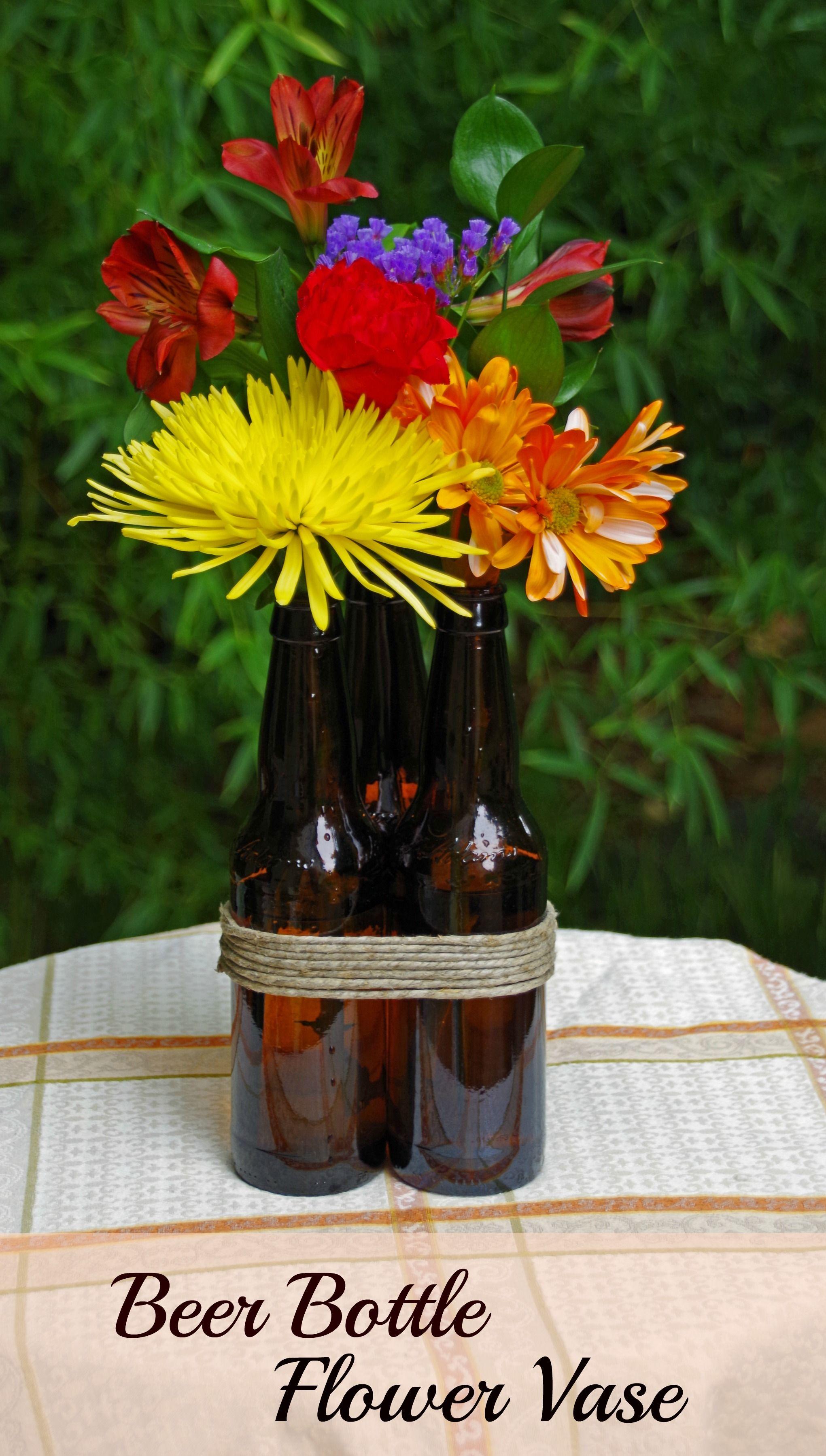 Diy beer bottle flower vase oktoberfest pinterest for Wine bottle flower vase