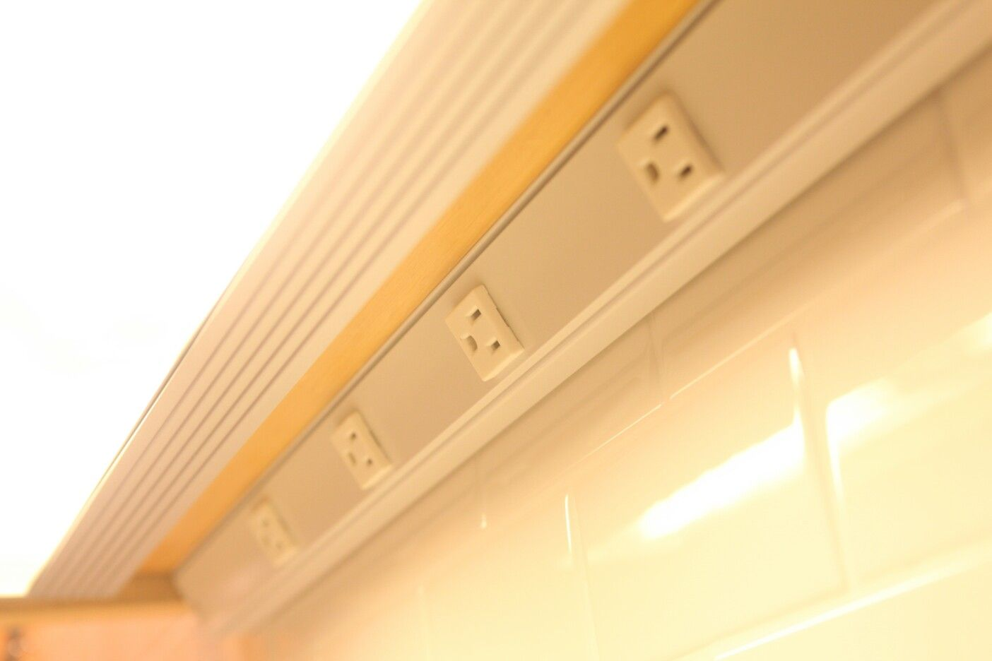 Keep Power Outlet Under The Kitchen Cabinet To Hide Them