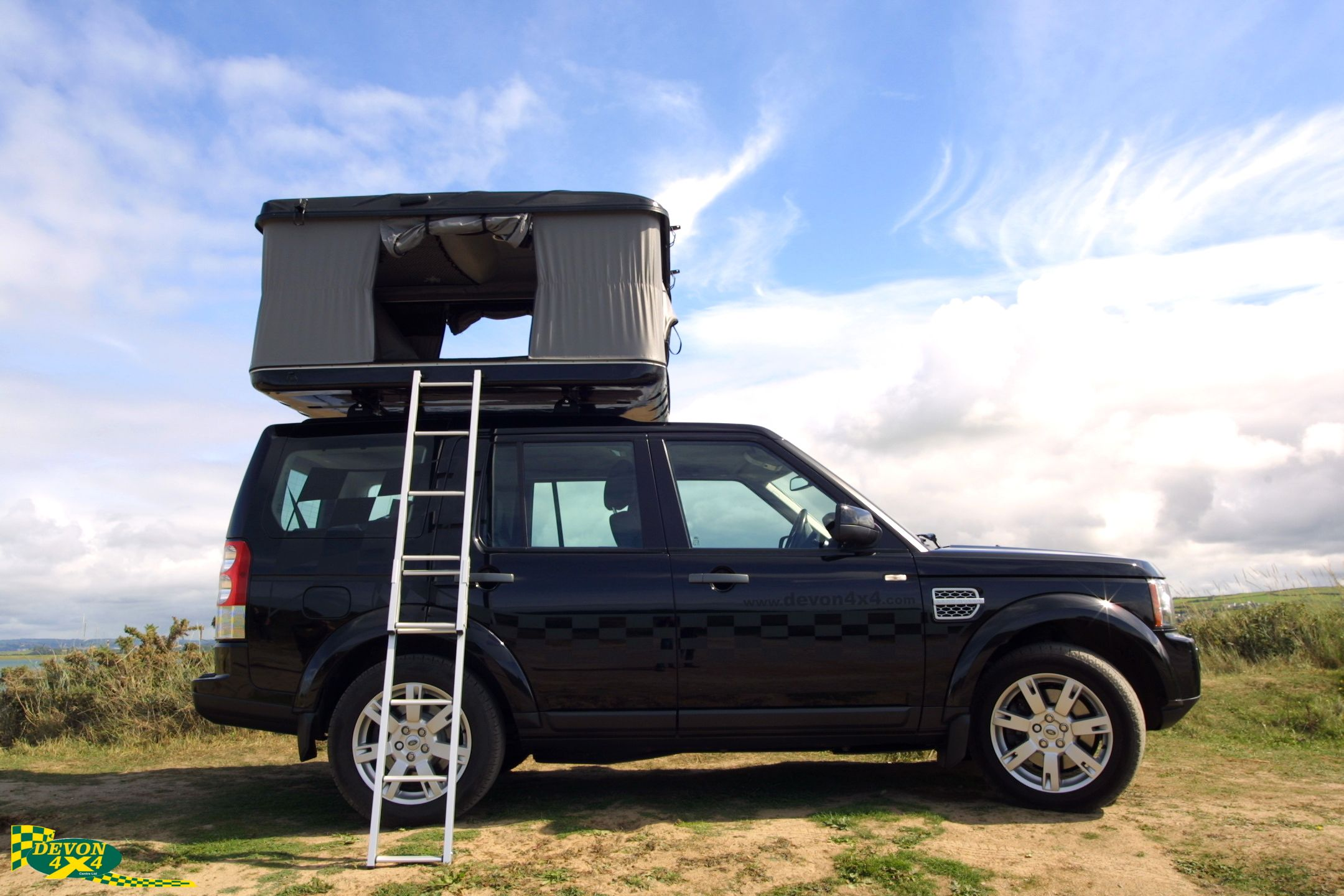 This is our Discovery 4 with a James Baroud Grand Raid Evolution Roof Top Tent ... & Hereu0027s a photo from our photoshoot down at Crow point Braunton ...