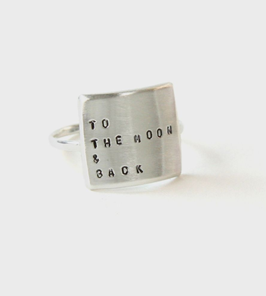 To The Moon & Back Message Ring   Stamped with teeny-tiny uppercase letters, this message ring m...   Rings