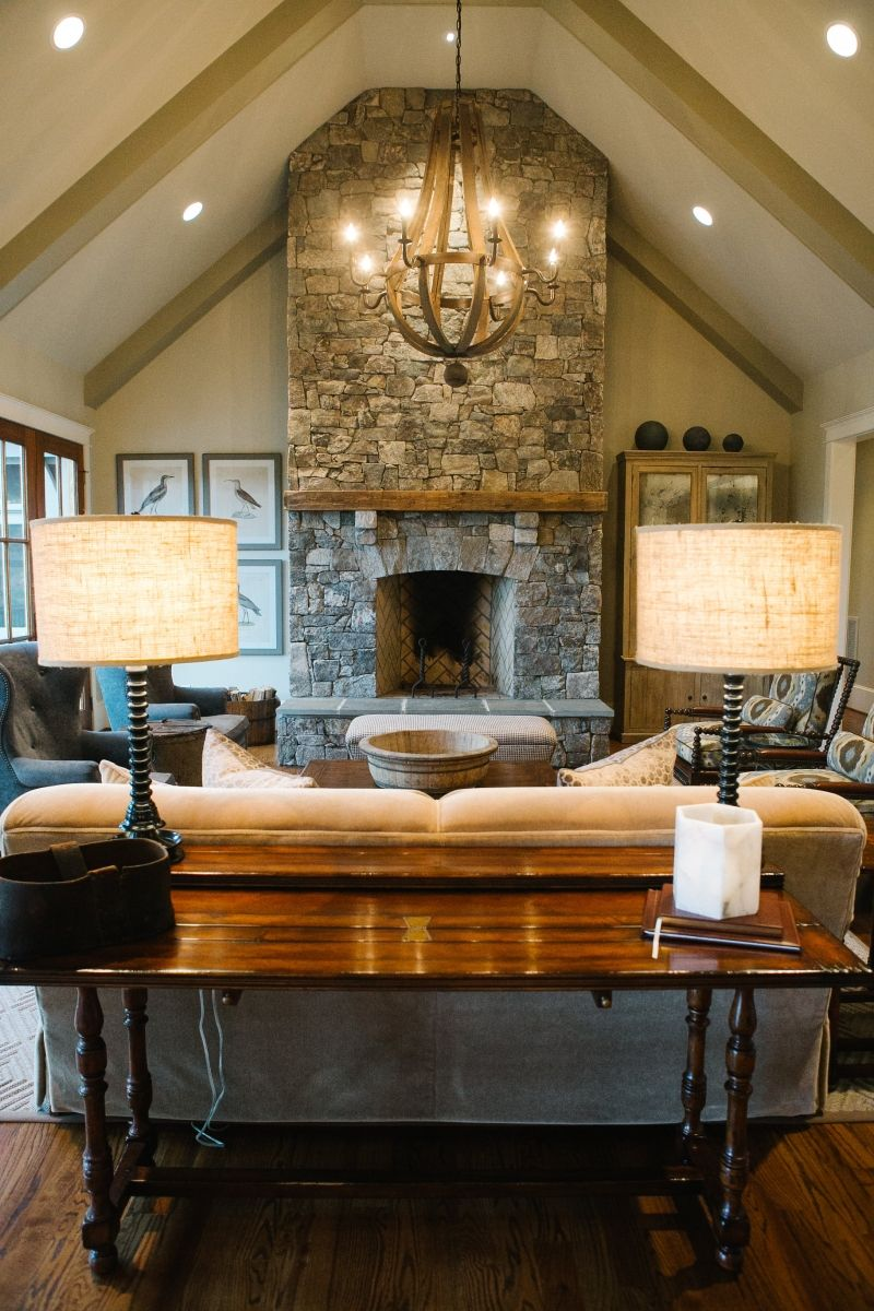 Gorgeous Living Room With A Vaulted Ceiling And Exposed Beams Stone Firep Vaulted Ceiling Living Room Ceiling Lights Living Room Cathedral Ceiling Living Room